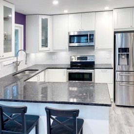 Full Kitchen Renovation with Dark Countertop and White Cabinet