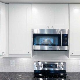 White Kitchen Cabinet with Dark Countertop